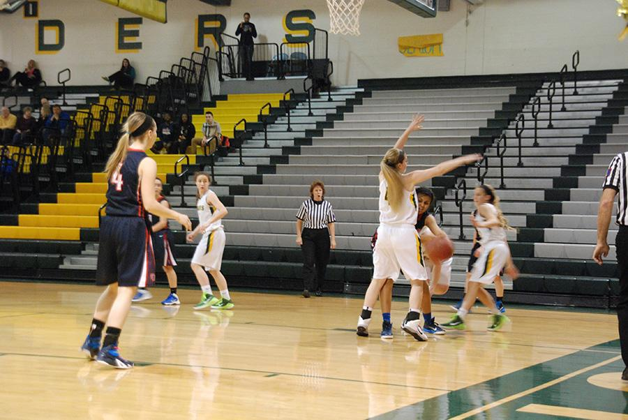 Senior+Nikki+Norton+back+on+defense.+Nikki+Norton+protected+her+basket+and+no+shot+was+made.