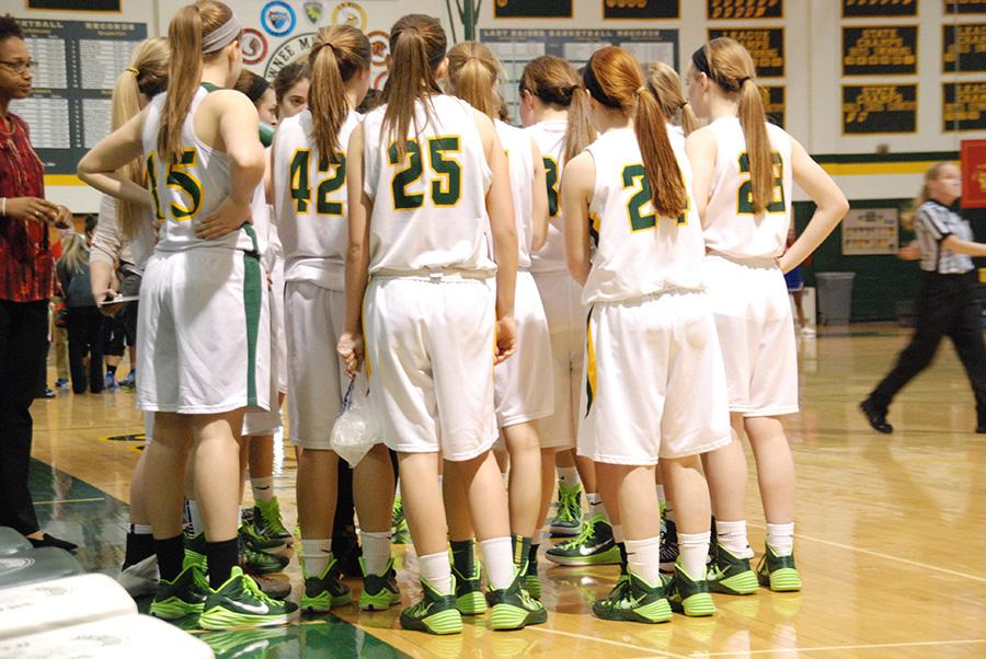 Varsity+team+huddles+up.+Head+coach+Kelsey+Hill+pumped+up+her+team+before+the+game+on+February+24.