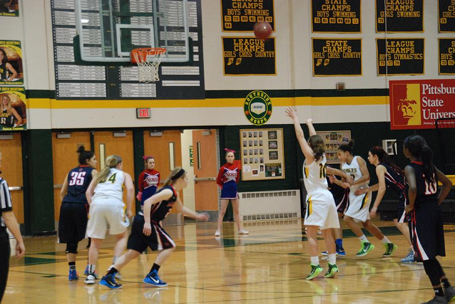 Senior+Megan+Stollsteimer+taking+her+penalty+shot+in+the+girls+basketball+game.+Megan+made+the+shot+to+add+another+point+on+the+score+board.