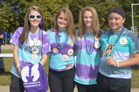 A group of South students made T-shirts and walked 3 laps to support the out of the darkness suicide prevention walk in honor of Sara Prideaux. Photo by Claire Johnson