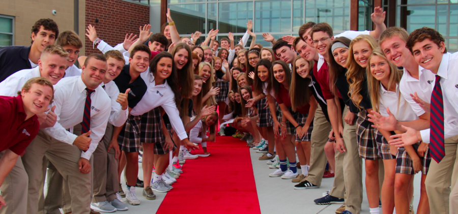 Seniors line up in front of the entrance to celebrate the beginning of the school year.