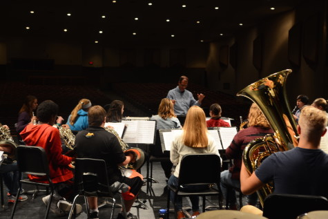 The symphonic band practices on the auditorium stage for the upcoming concert.