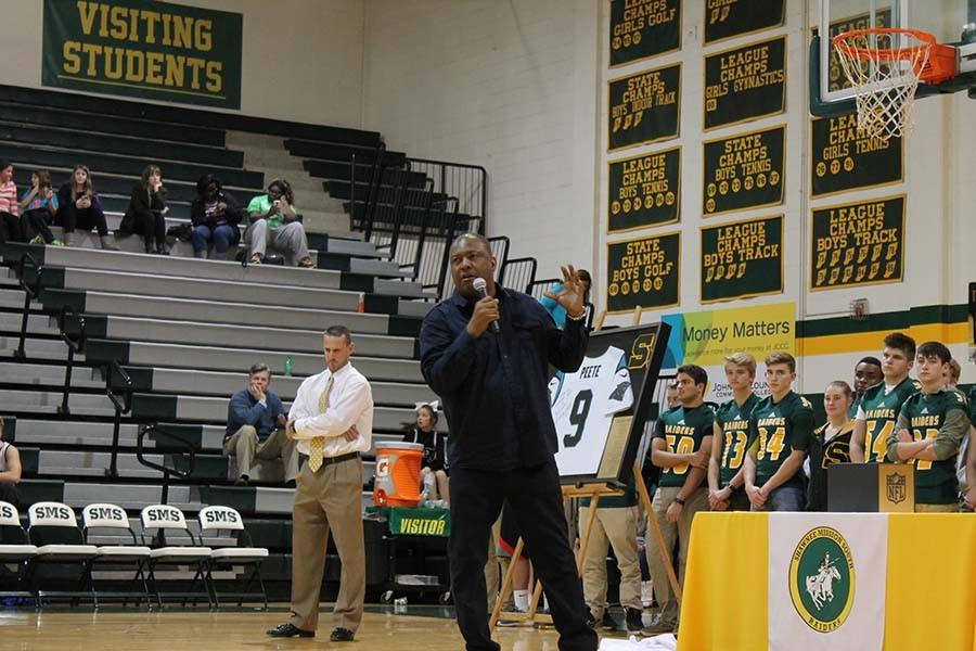 Peete presented his #9 jersey, signed and framed, that is hung in the hallway adjacent to the main gym lobby.