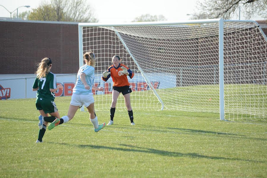 During the JV soccer game against SM East, Junior Morgan Cossairt tries to defend the ball.