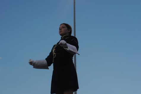 Drum Major Jocelyn Clark conducts the Rompin' Stomping' Raider Band's pregame show.