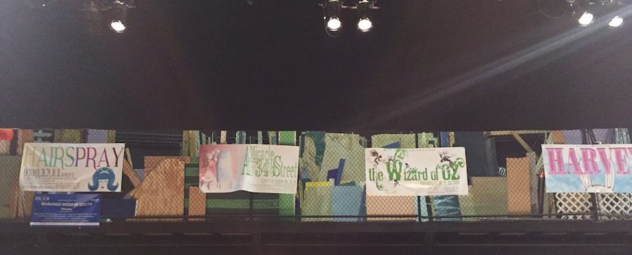 Banners from last seasons shows decorate the stage of the theatre.