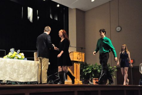 New National Honor Society members are initiated during the ceremony in the auditorium. photo by Kice Mansi