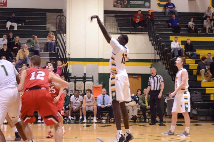Junior Yor Anei making a free shot.