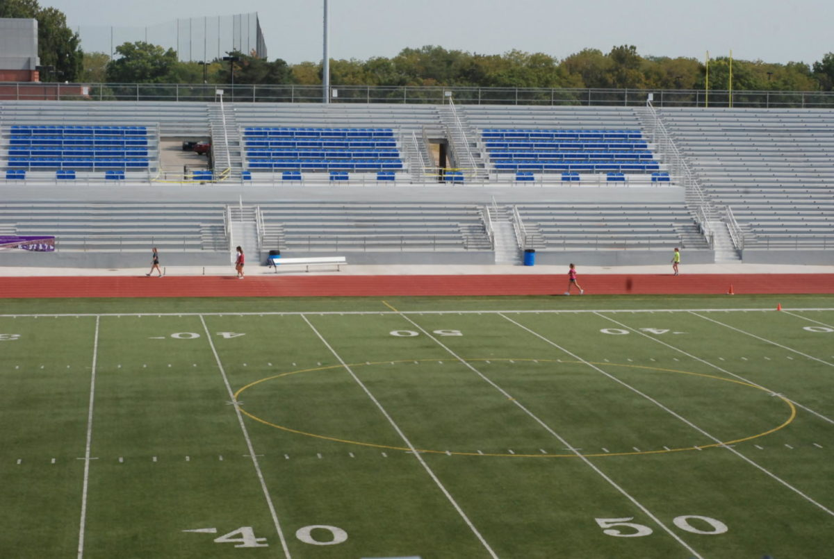 Look right onto the 50 yard line of the new field and stadium. From the west side of the stadium looking onto the middle of the field and looking right onto the east side of the stadium which is equipped with all new chairs, stands, etc.