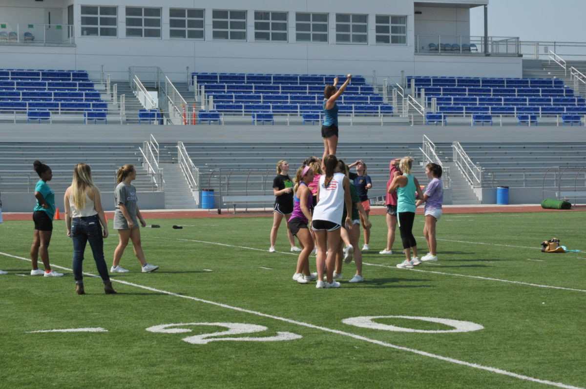 Let's Go Raiders! These cheerleaders are practicing on the field during seventh hour in the recently updated stadium. Most people are enjoying the new additions to the field, but others have different ideas.