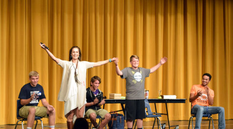 Singing her way to Broadway. Former Miss Kansas Adrienne Bulinski sang to a group og eight boys to break the ice before the presentation. Bulinski shared her four steps to success and how she experienced each step. photo by: Parrish Mock