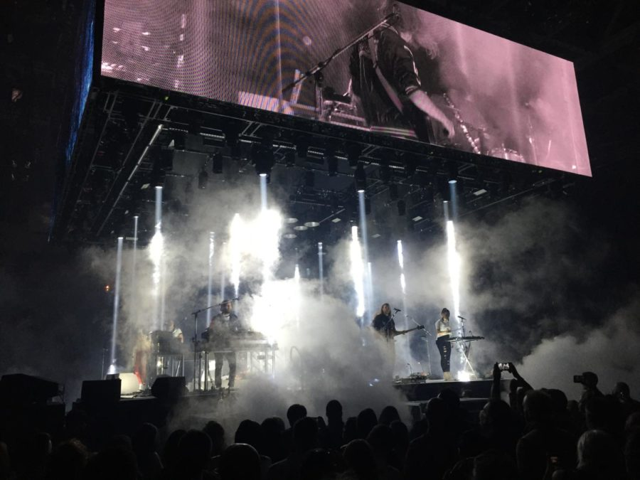 Arcade Fire performing the song