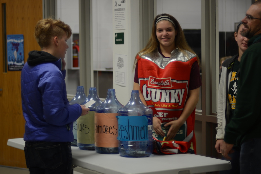 Also to collect more money,  junior Emma Ross, helps with the penny drop while rocking the chunky beef stew costume.