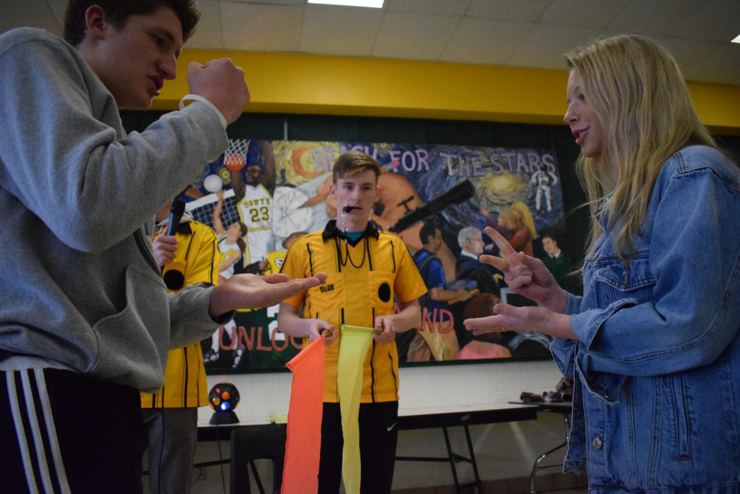 As part of KSMS activities, senior Kameron Ozburn officiates the Rock Paper Scissors match.