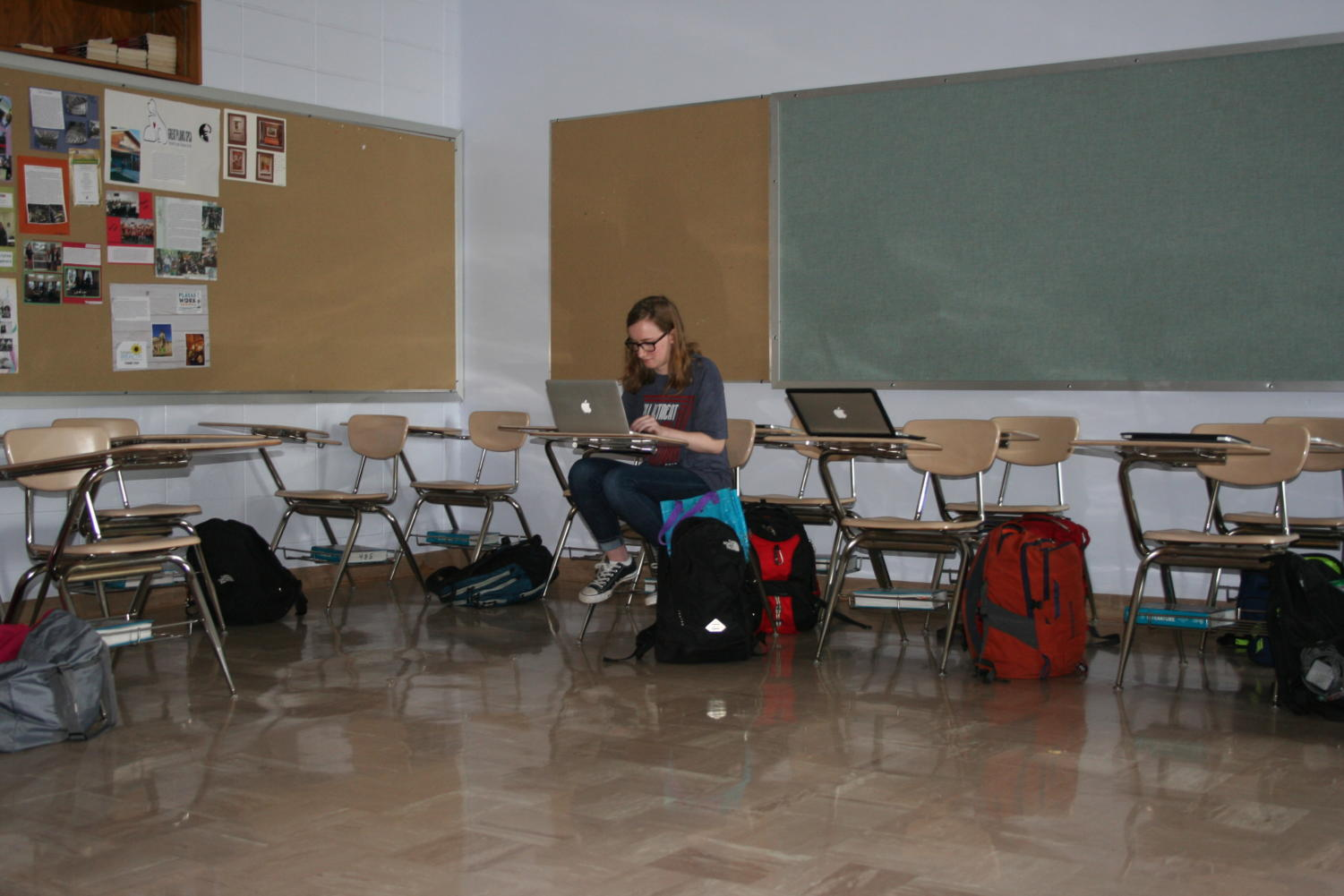 In the middle of the walkout, sophomore Emma Horton sits alone with her substitute teacher in her third hour classroom.