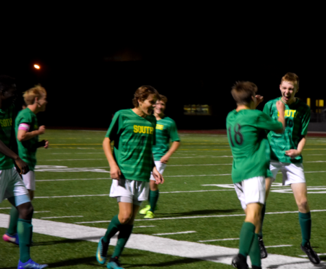 The Raiders celebrate during their game. The Varsity boys defeated the Olathe North Eagles 4-2 on Monday, Oct. 22.