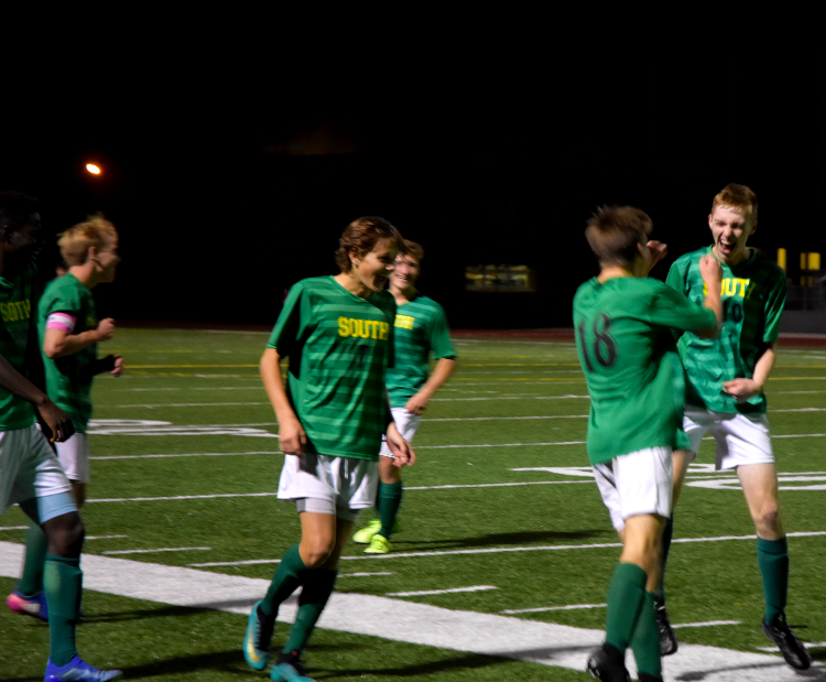 The+Raiders+celebrate+during+their+game.+The+Varsity+boys+defeated+the+Olathe+North+Eagles+4-2+on+Monday%2C+Oct.+22.