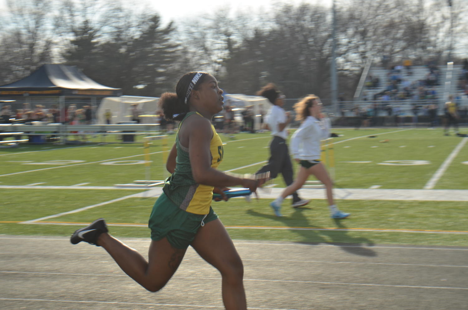Junior Yasmeen Byers runs relays at the first track meet this season. She finishes in second place.