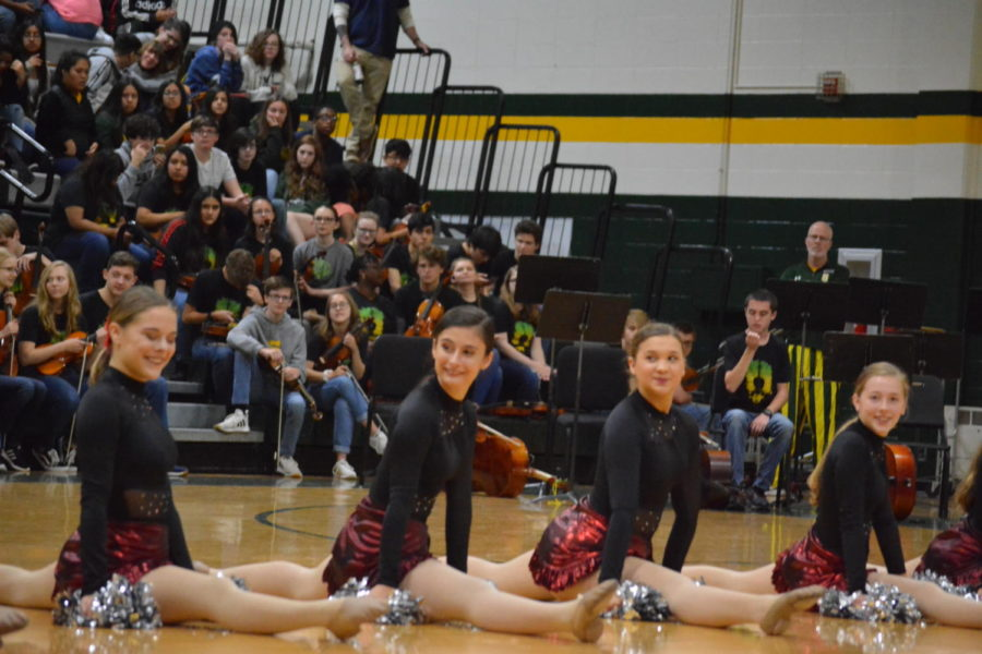 Varsity Pacesetters drop into right-leg splits as their names are announced before their performance. The performed one of their competition dances.