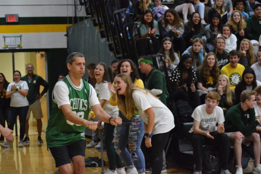 Teacher Mr. Budetti runs into the gym for the falculty dodgeball game. The social studies department won again this year.