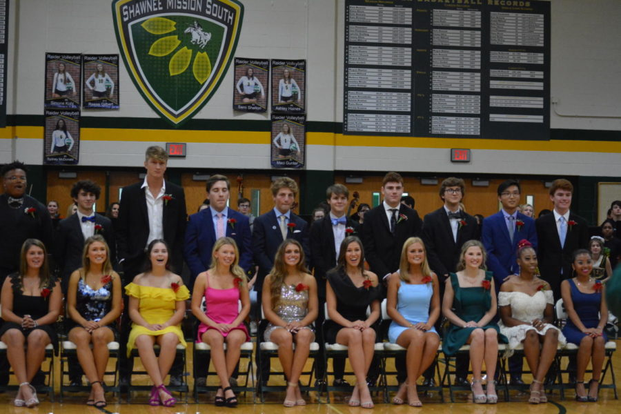 The homecoming candidates pose for a group photo. The winners were announced before the game started.