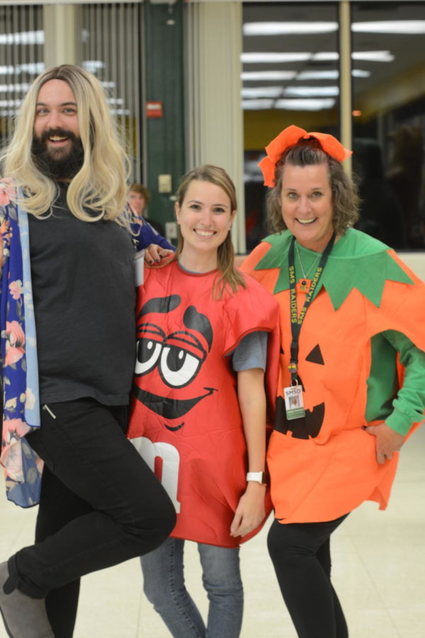 Mr. Love, Mrs. Johnson, and Ms. Neuman all dressed up and excited for trunk or treat.