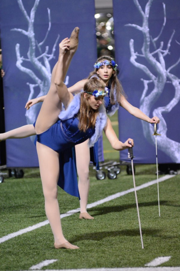 Senior Elory Vaughn dancing as a fairy to the Rompin' Stompin' Riader Band's performance, at the Shawnee Mission District Band Festival.