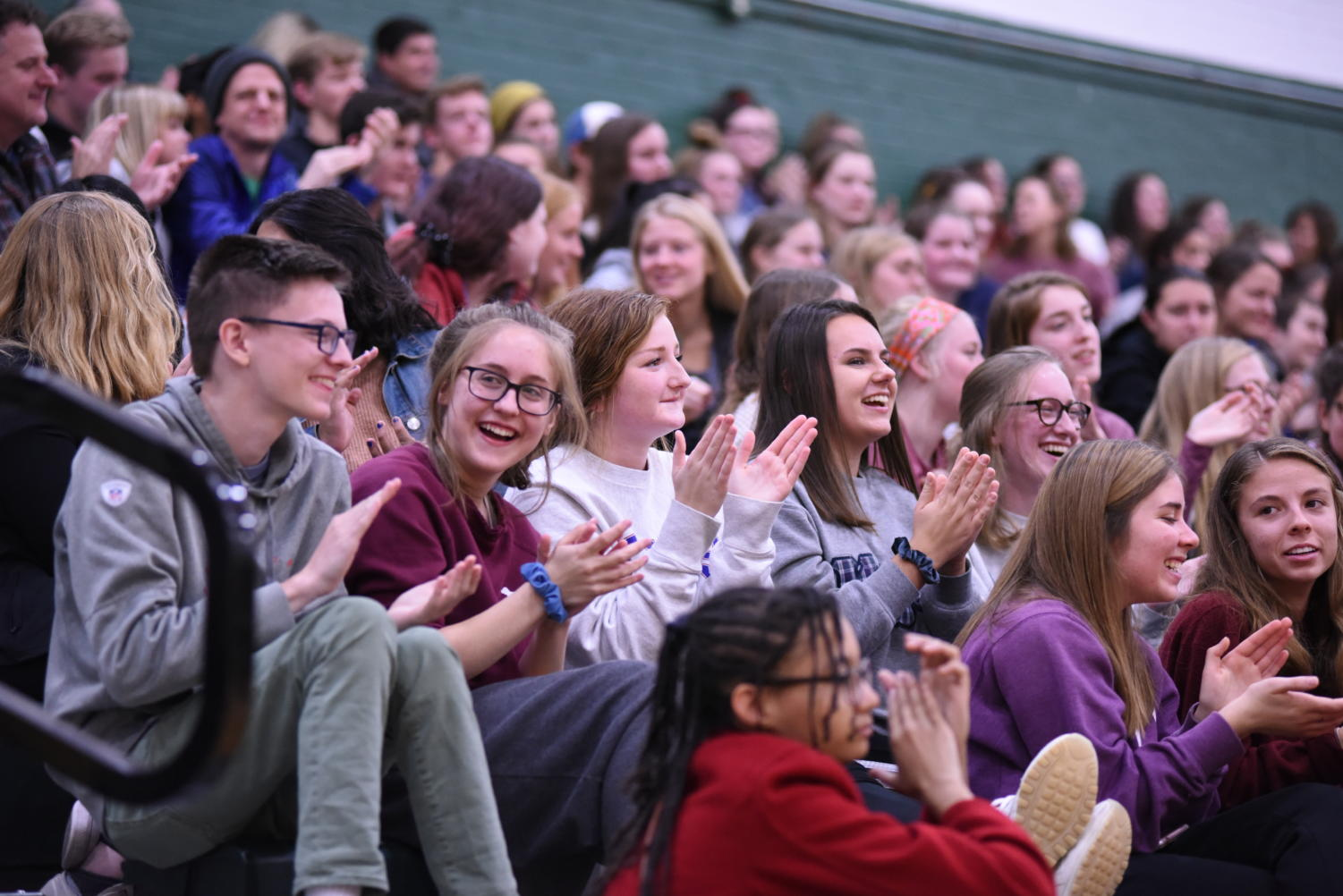 The crowd laughs and applauds a joke made by a contestant in the Mr. AmeriCAN pageant. The pageant was an event held by student council to raise cans and money for the community.