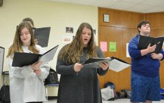 Students rehearse for the Masterworks concert. They use no music since they are in the a capella choir.