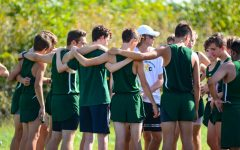 The boys huddle up at the top of the hill in SM park for the JV meet. On Sept. 16 the girls were just finishing up their meet as the alumni gives the boys their own pep talk before their race.